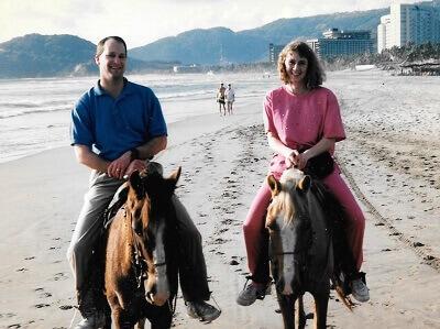 Tom & Becky Dean on horses on the beach in Acapulco