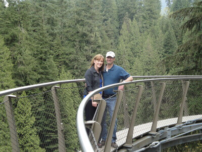 Tom & Becky Dean on a glass aerial bridge